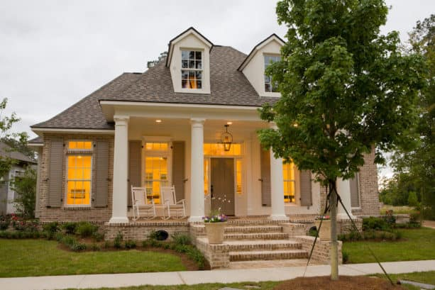 tan and white home exterior with beige shutters