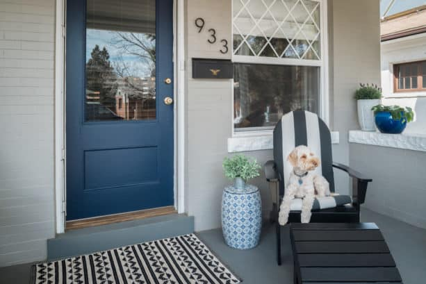 navy blue entry for a gray house and white trim combination
