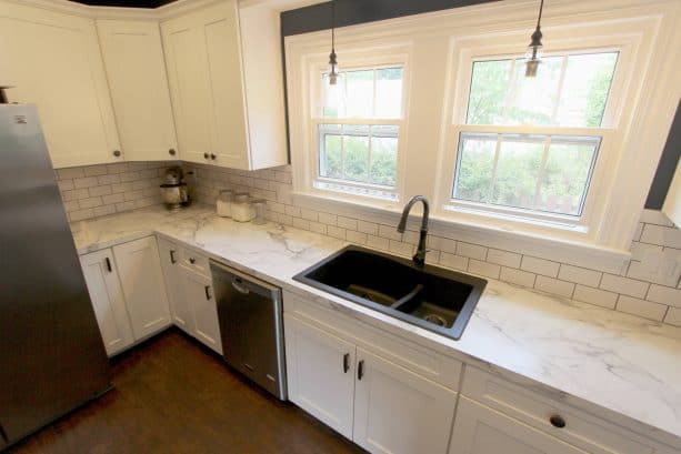 kitchen with antique white cabinets and laminate countertops with white granite look