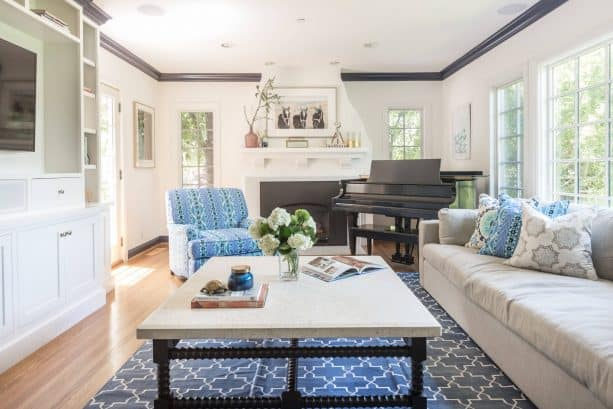 grey and blue transitional living room with patterned rug and amrchair