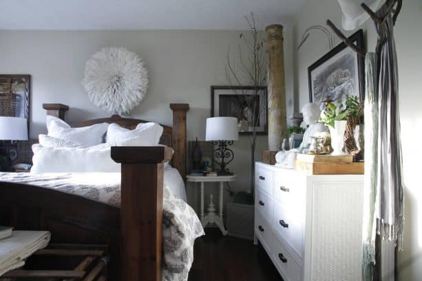 grey and white bedroom with wood brown wooden bed