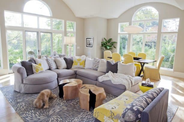 grey and yellow living room with yellow floral-patterned armless chair