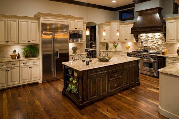 off-white cabinets with gold granite countertops