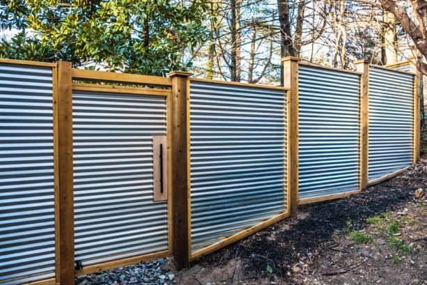 corrugated metal fence built on sloped land