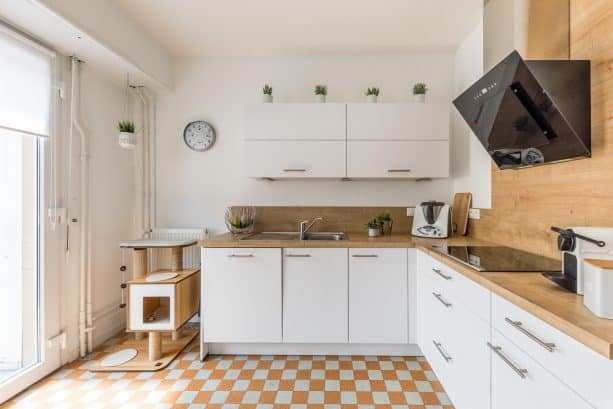 airy and bright white kitchen with brown wooden backsplash and countertops