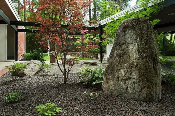 a relaxing simple landscape with large boulders and mulch
