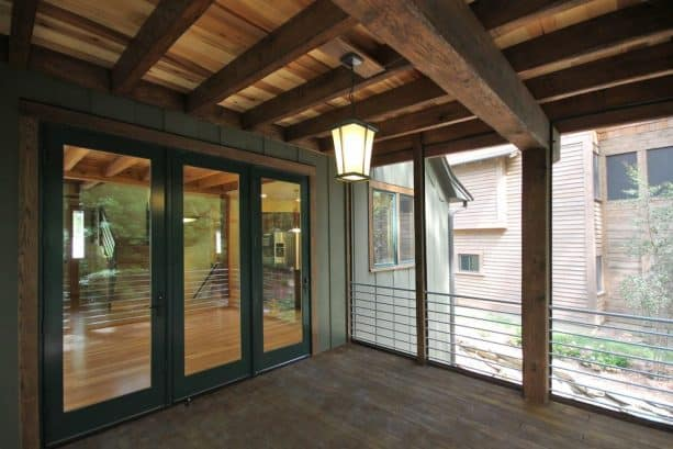 a masculine-looking porch with clear poplar tongue and groove ceiling