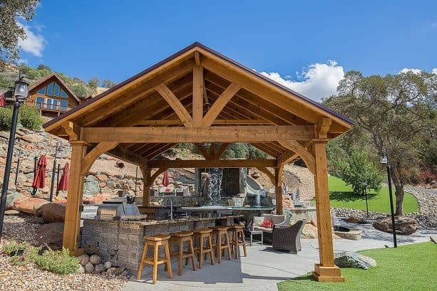 outdoor kitchen and pavilion with tongue and groove roof deck