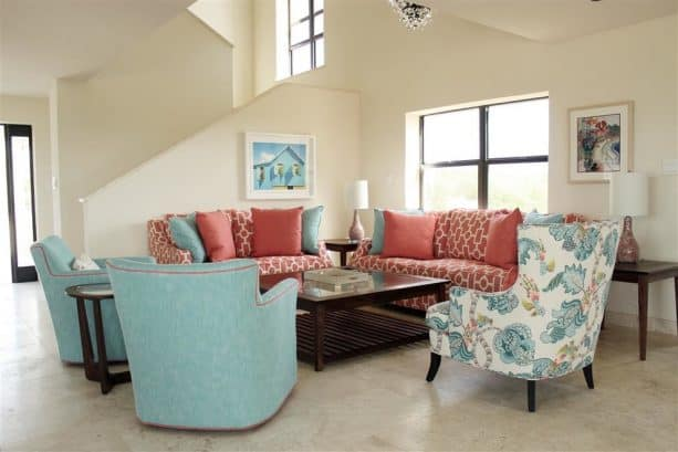 turquoise and coral furniture in a beach-style living room