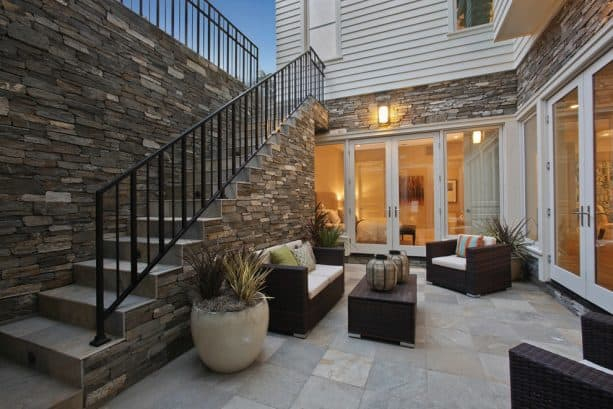an outdoor living area on a walkout basement patio