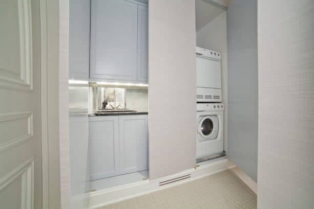 a hidden laundry closet behind the flat doors