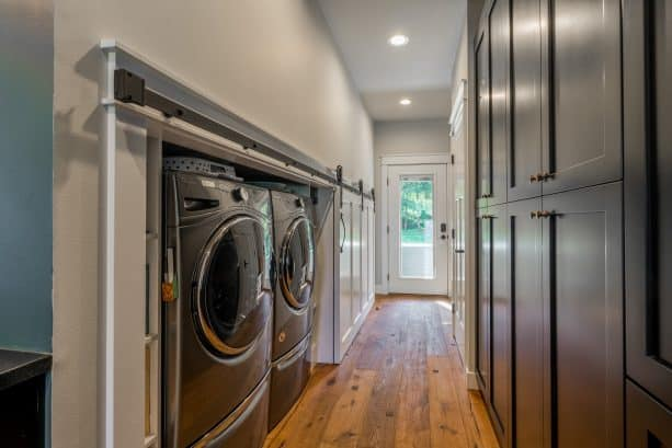 a low laundry closet with special white sliding door