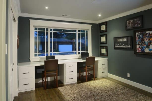 a craftsman home office with window casing and simple crown molding