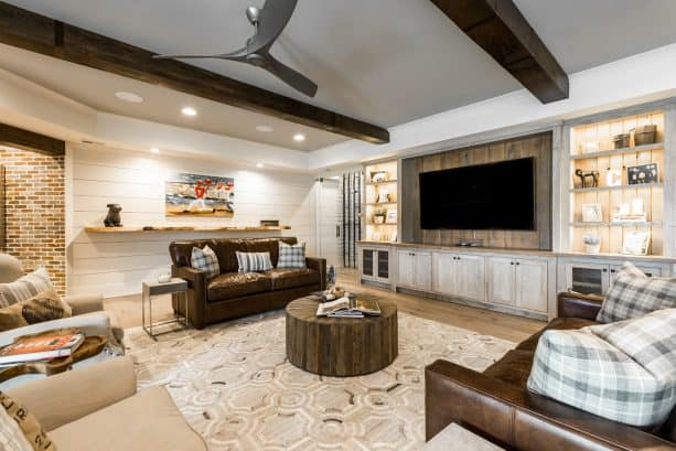 a living room interior with industrial farmhouse style and exposed wood beams as one of the attention-stealer