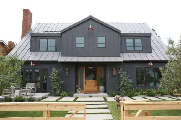 a dark farmhouse exterior with Wrought Iron 2124-10 black paint color from Benjamin Moore