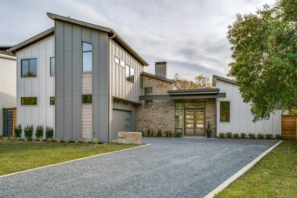 a mixture between transitional and farmhouse exterior with Gauntlet Gray SW 7019 paint color