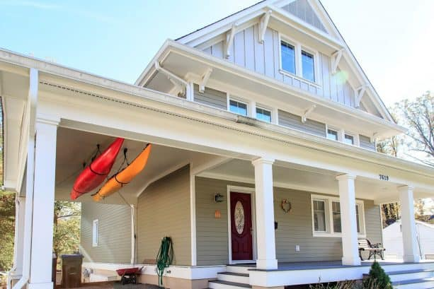 a closer look to the space-saving, hanging canoe storage on the attached carport ceiling
