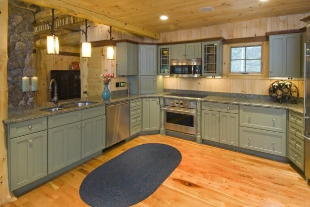 adorable sage green cabinets in a unique designed kitchen