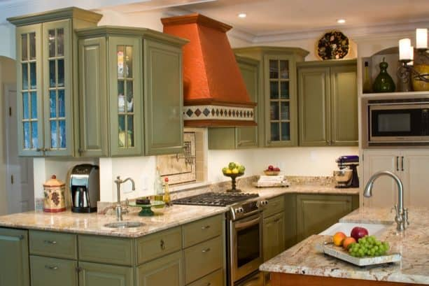 edgy and romantic kitchen with sage green cabinets in a french country style