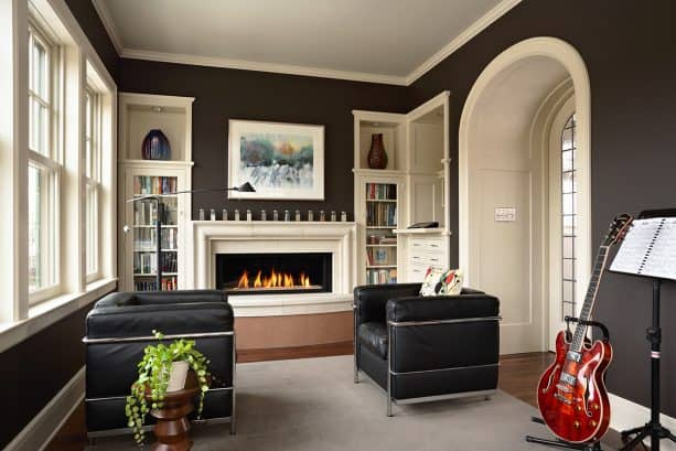 black and white stone fireplace and narrow built-in shelves