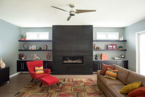 modern living room with black fireplace and built-in shelves around
