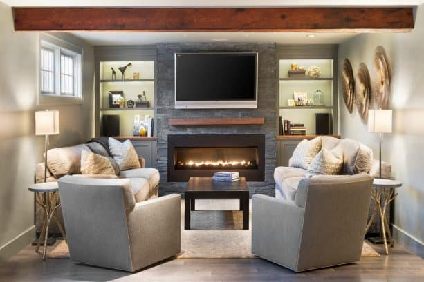wood built-in shelves around a stone fireplace