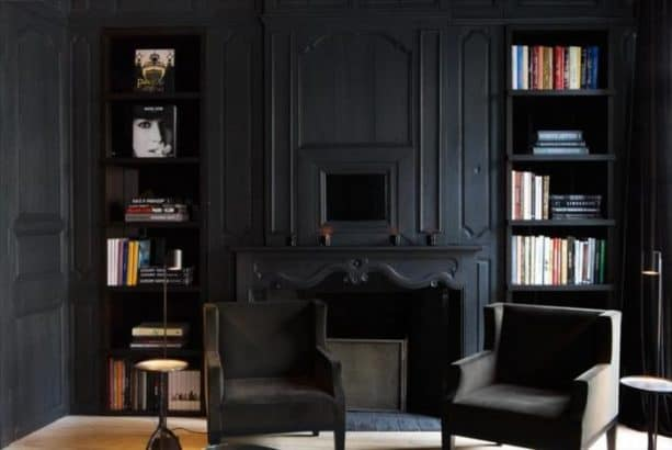 living room with matte black wall and trim paint color