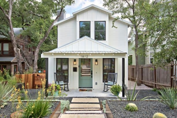 a fabulous farmhouse exterior with Simply White OC-117 paint for the siding and Azores AF-495 for the front door