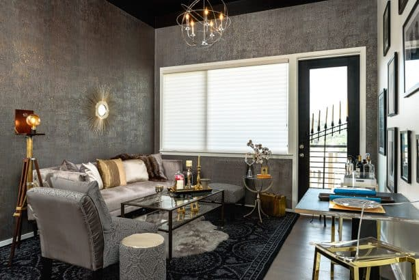 gray floor living room with elegant gold color decorations