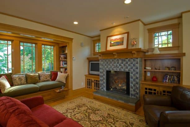 a tile-surround fireplace with douglas fir built-in book shelves