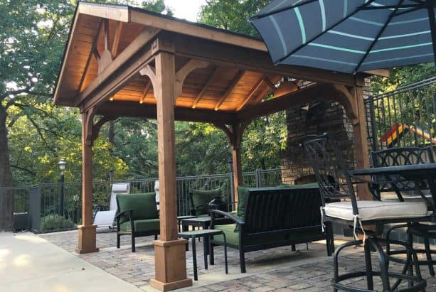 a roofed outdoor living room with cedar tongue and groove roof deck