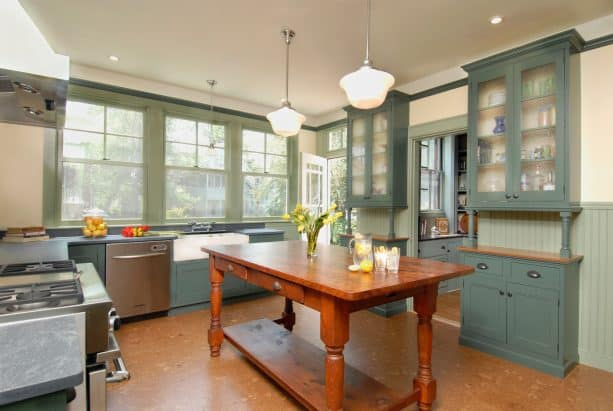 lovely rustic kitchen furnished by sage green cabinets and stainless steel appliances