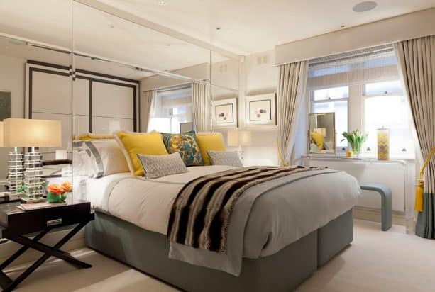curtains, a contemporary acrylic table, and a bench to decorate a short wide bedroom window