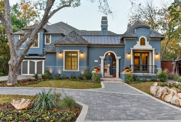creating a unique exterior design with the combo of greyish blue stucco and white trim