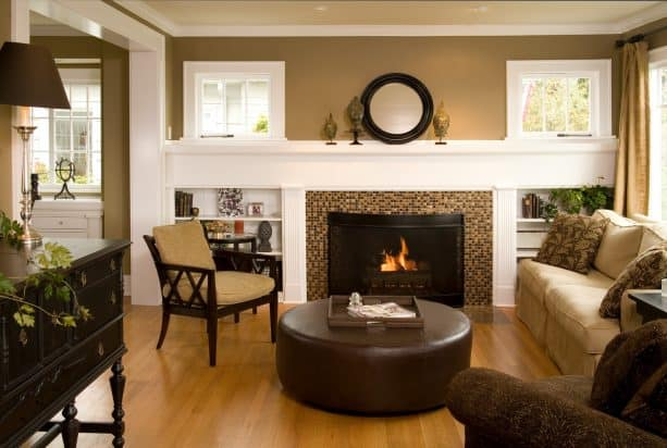 warm and traditional living room with low built-in shelves around fireplace