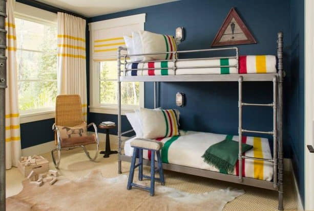 rustic kids' bedroom with Farrow & Ball Hague Blue No. 30 blue wall paint color