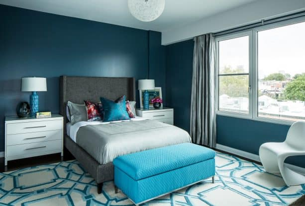 teal dominated contemporary bedroom with charcoal gray bed