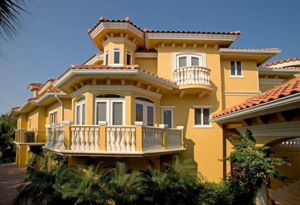 the use of yellow stucco and white trim in Mediterranean exterior