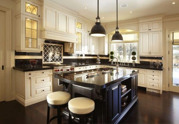 cream cabinets with polished brown granite tops