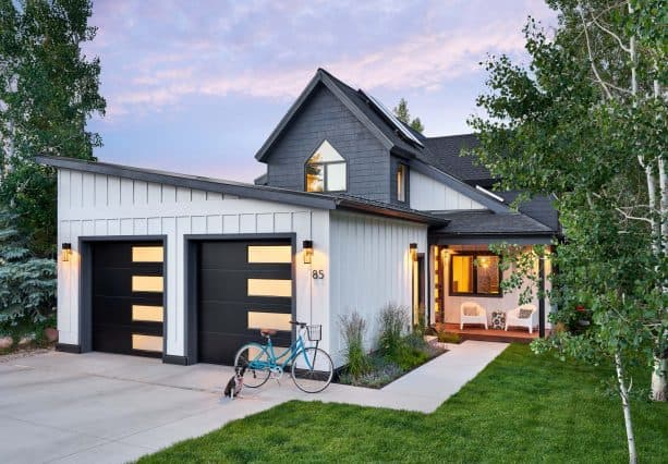 a garage addition in front of transitional-style house