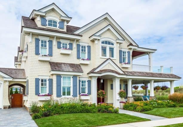 a whiter-exterior house design collaborated with blue shutters by atlantic premium