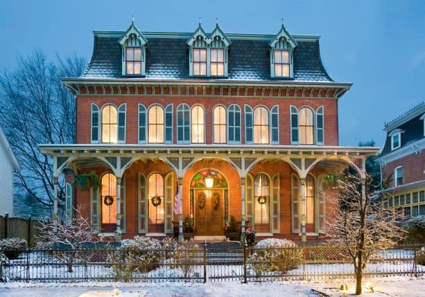 victorian house with a touch of gothic style in a red brick and hunter green shutters