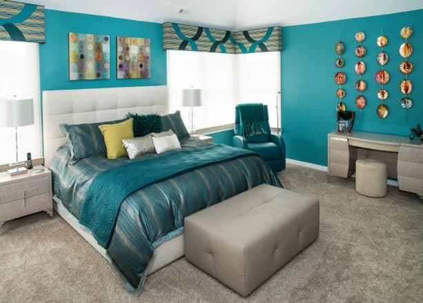 mid-sized trendy master bedroom with teal walls and full ash gray carpet tile