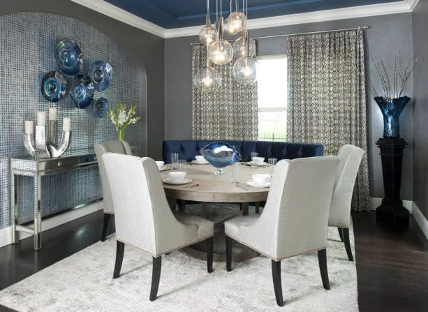 a dining room with light grey and navy theme