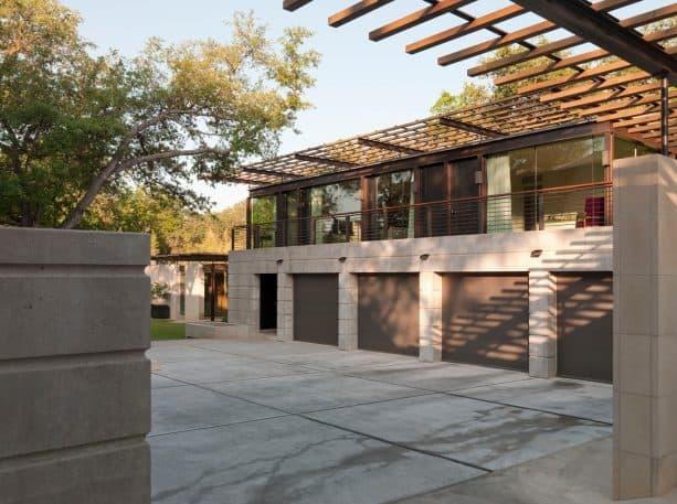 trendy four-car apartment garage with bronze clopay metal door