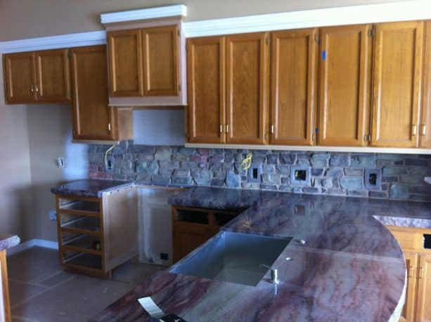 the yellow oak cabinets look ordinary before being updated