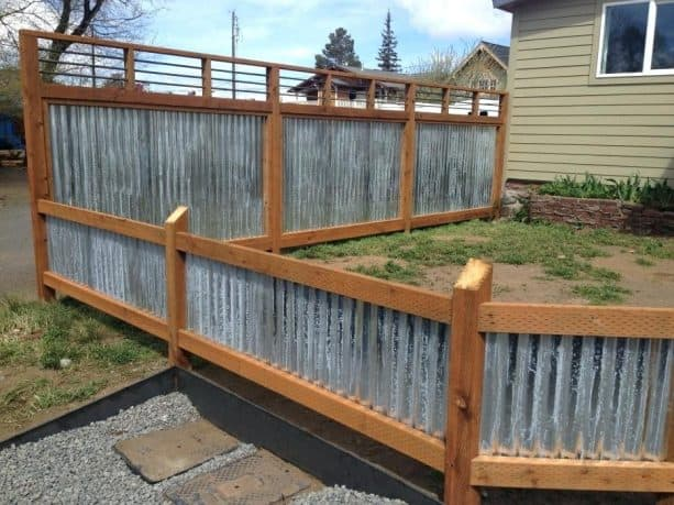 short wood-framed corrugated metal fence
