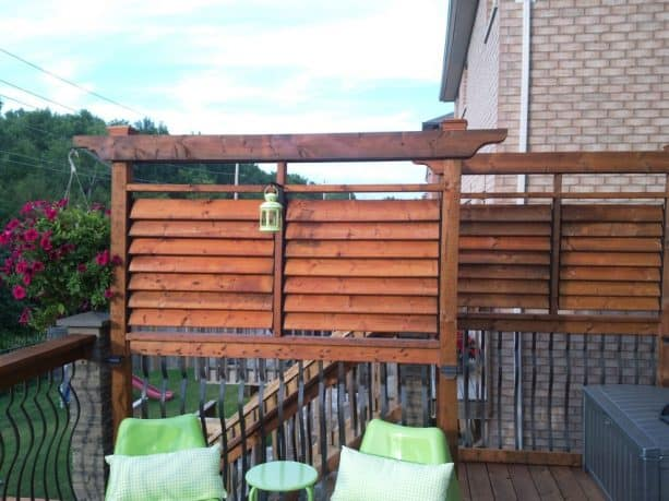 traditional deck with rustic louver screen