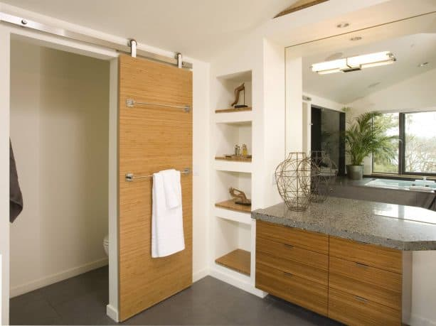 contemporary bathroom barn door with towel hangers