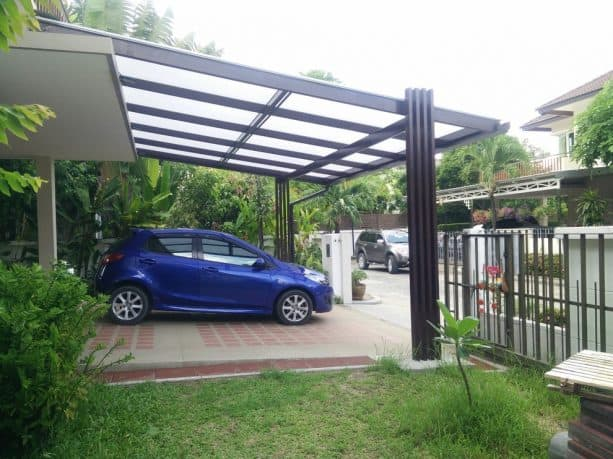 a modern house with semi-transparent attached carport for two cars